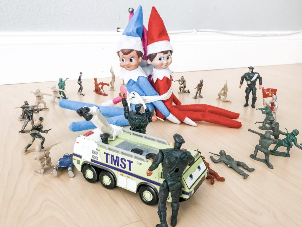 Elf on the Shelf captured by army men