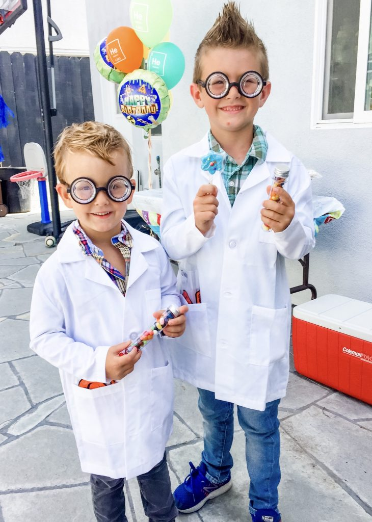 2 children dressed as mad scientists